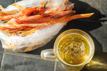 gold beer with fish