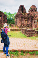 Girl taking photo of ruins Old hindu temples My Son