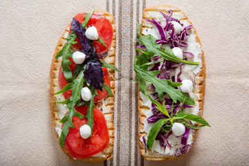 Toast with tomato, arugula, rucola, mozarella cheese, bread and greens