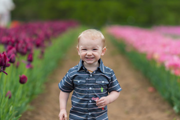 Smiling Baby In Flowers