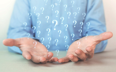 Man holding question marks. Business concept