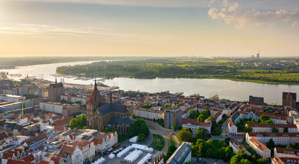 aerial view of rostock, germany in the evening - river warnow in the background
