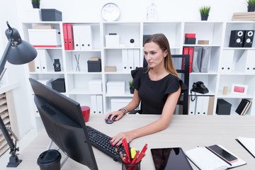 Young girl in black dress in the office