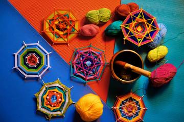 Knitted mandala, yarn, tibetan singing bowl on bright background