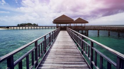 Wooden Beach Dock or Wooden Pier at Beautiful Tropical Beach