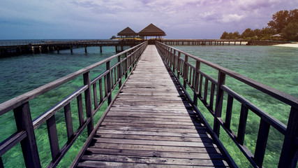 Wooden Beach Dock or Wooden Pier at Beautiful Tropical Beach