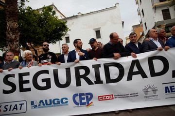People hold a banner during a protest against drug trafficking and insecurity in the Campo de Gibraltar area, in Algeciras