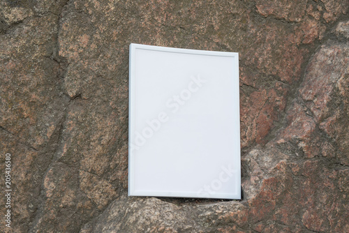 White frame on the background of a rock\