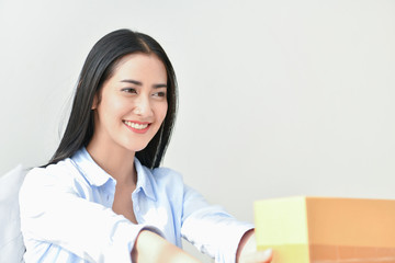 Sme business concept. Young people are packing their packages.Delivery business  Small and Medium Enterprise (SMEs). Young woman is working in the house.Young Owner Start up for Business Online.