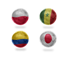 soccer team group H. football balls with national flags of poland, senegal, colombia, japan