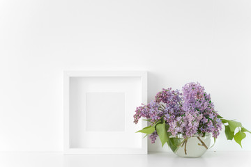 White square frame with lilac bouquet on white background