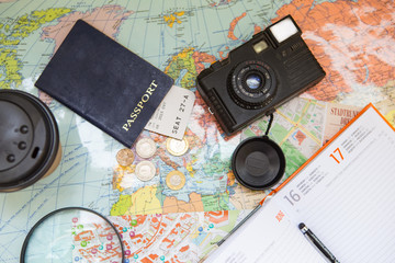 Passport, camera, map, magnifier and daybook. Planning traveling concept