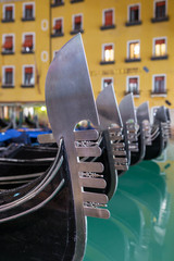 Foto auf AluDibond Gondeln Close-up view of a venetian gondola metal design at the prow in Venice, Italy