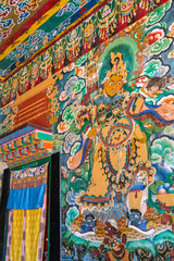 Gangtok, India - May 2, 2017: Mural paintings in the buddhist Rumtek monastery temple in Gangtok, India