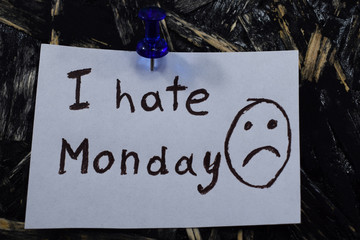 inscription I hate Monday on a white sheet of paper