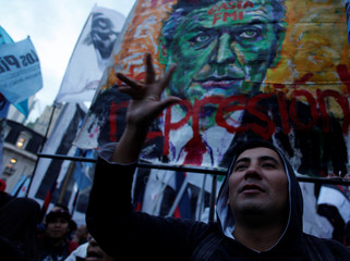 A demonstrator shouts slogans during a protest against the economic measures taken by Argentine Macri's government in Buenos Aires