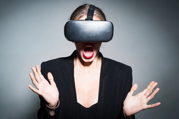 Virtual reality goggles. Girl using virtual reality headset. Virtual reality device. Headset with virtual screen.