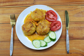 lunch, sauce with meat cutlets and with fresh tomatoes and cucumbers