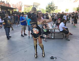 Season ticket-holder and Golden Knights fan Stephanie Huntsman sports a Wonder Woman costume and poses with fans prior to a home game at the T-Mobile Arena in Las Vegas