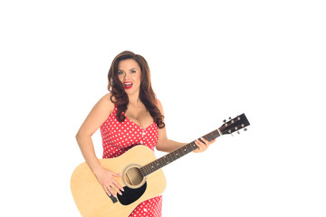 artistic plus size woman playing acoustic guitar isolated on white