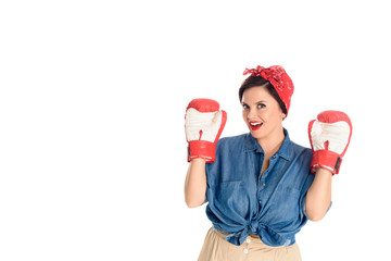 beautiful pin up woman in boxing gloves smiling at camera isolated on white