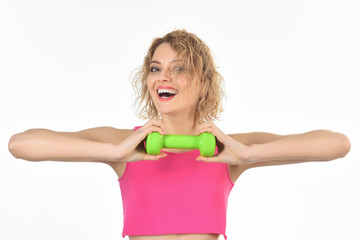Workout. Fitness. Sport concept. Blonde girl holds green dumbbells. Fitness girl. Healthy lifestyle. Training. Sport costume. Copy space.