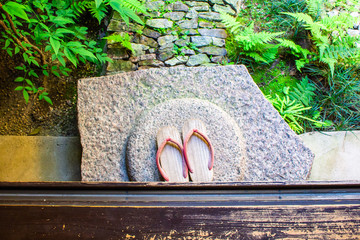 With Japanese sandals
