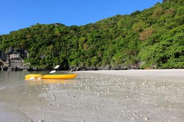 Kayaking on the white sand beach at limestone island Gulf of Thailand