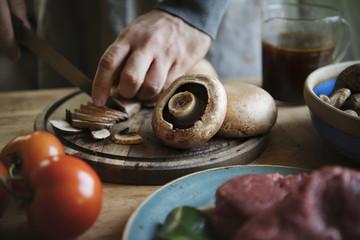 Closeup of slicing a mushroom food photography recipe idea