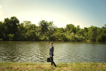 Businessman lost in the nature