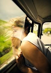 Girl feeling the wind in her hair