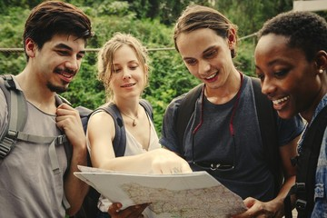 Friends checking where to go on a map