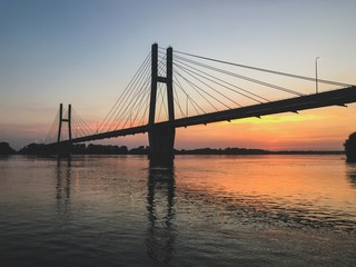 Suspension Bridge at Sunset over Mississippi River