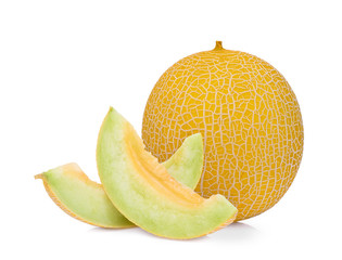 whole and slice of  pearl orange melon solated on white background