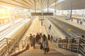 Passengers at railway.