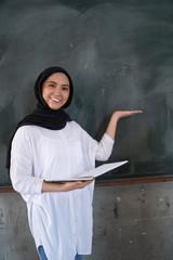 teacher is showing at blackboard