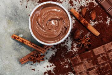 Chocolate bars on table with chocolate powder.