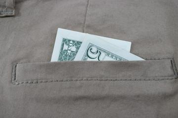 money in pants pockets, 5 dollars in jeans pockets
