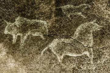 An image of ancient animals depicted on the wall of a cave. ancient history. drawings of an ancient man. ancient art.