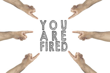 You are fired. Hr concept. Hands pointing the text you're fired.