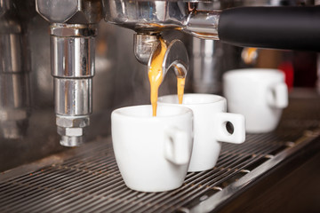 Close up of traditional Espresso Coffee Machine making two cups of espresso coffee.
