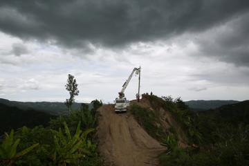 Residents of La Chorrera neighbourhood work on an electricity pole in Utuado