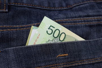 money in pants pockets, Argentine 500 pesos in jeans pockets