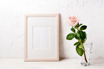 Wooden frame mockup with pink rose