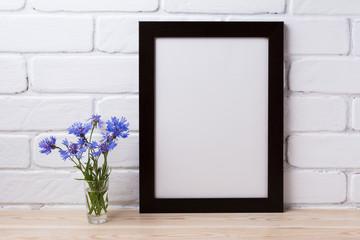 Black brown poster frame mockup with cornflower