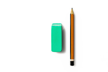 Pencil and eraser on white background. Close up of a orange and black wooden pen and an eraser green.