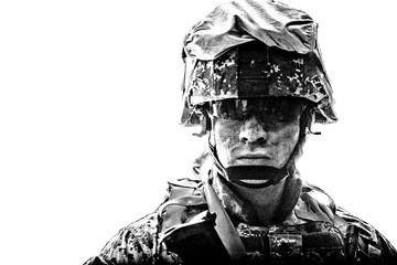 Shoulder black and white portrait of modern army infantry soldier with dirty face in digital camouflage battle uniform, combat helmet, tactical sunglasses looking at camera desaturated, isolated on