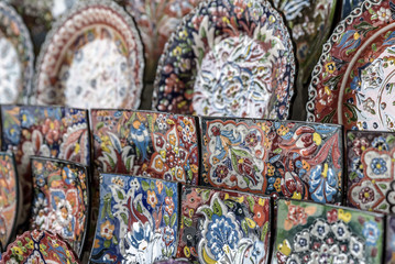 Beautiful, colorful ceramic plates, for sale in a Dubai Souk. The plates have finely detailed, Arabian patterns on them