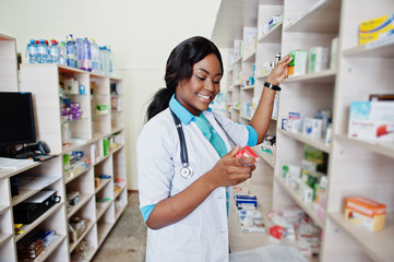 African American Pharmacist Cashier Working In Drugstore At Hospital