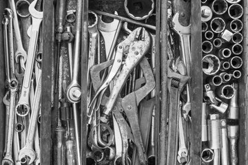 Many tools in rustic compartments toolbox. Technical machanic toolset for car automobile, motorcycle repair or DIY. - Black and white tone